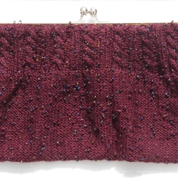 'Bone' clutch bag using pre-beaded silk yarn.
