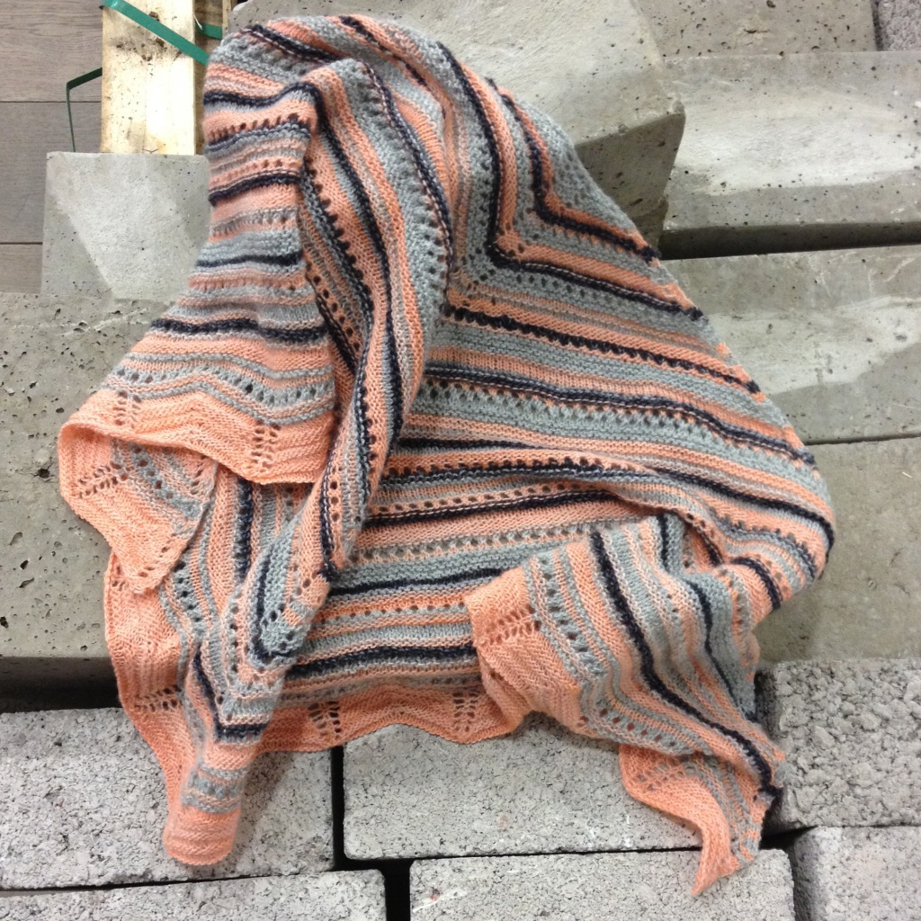 apricot knitted scarf on bricks