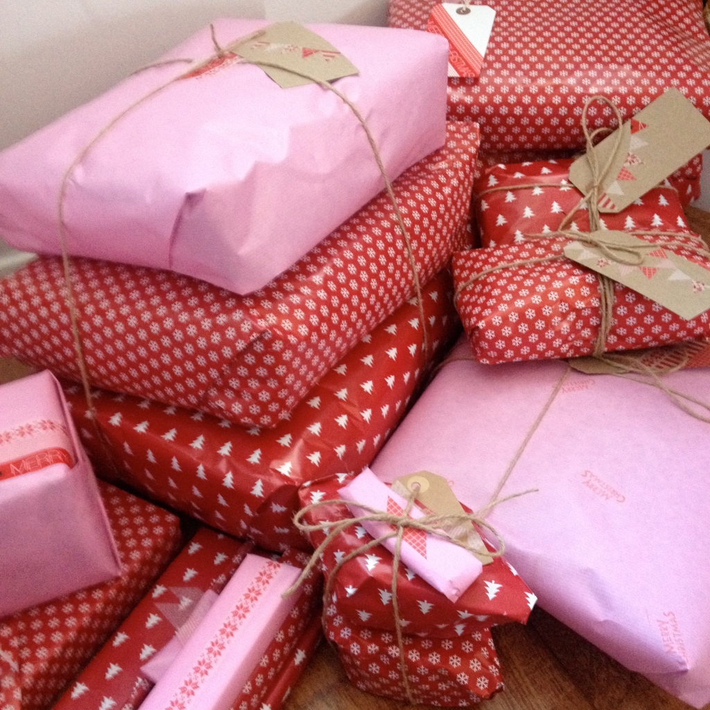 christmas present wrapping pink red white