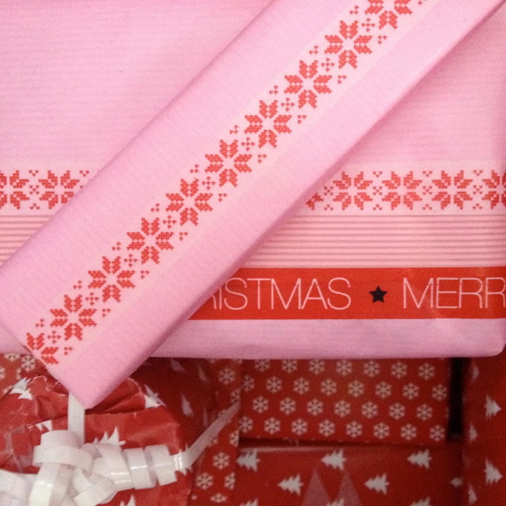 pink christmas wrapping with wash tape
