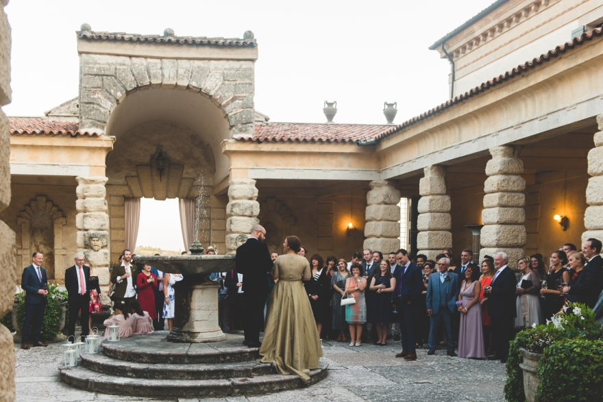 gold wedding dress train italy courtyard fountain